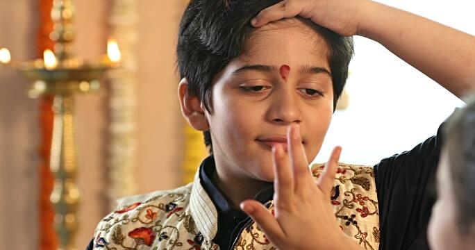 Applying Tika or Raksha Bandhan