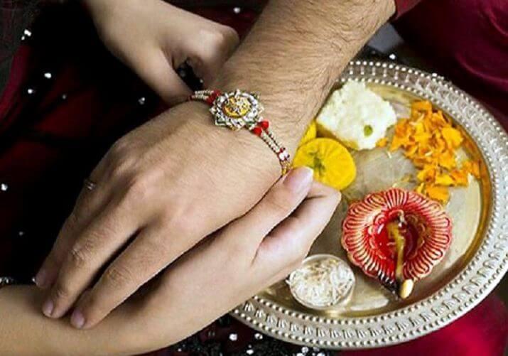 Sister Tying Rakhi to Brother's Hand - Raksha Bandhan Celebration